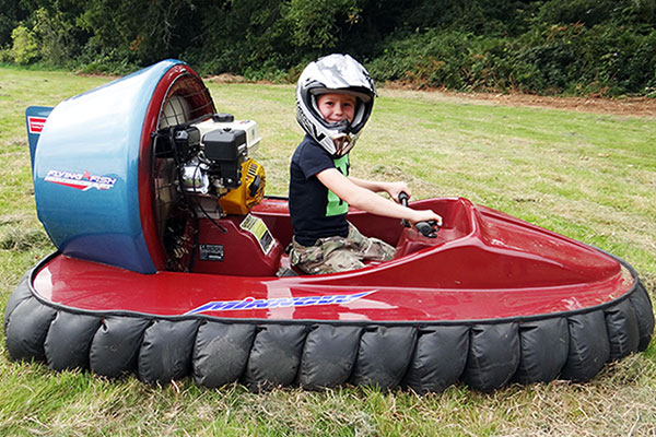 child driving a hovercraft on his birthday
