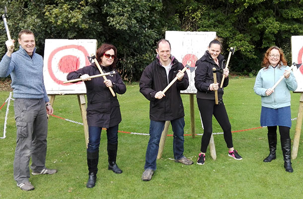team building axe throwing corporate event with staff